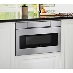 Sharp SMD2470AS 24-inch Stainless Steel Microwave Drawer. On the side if the lower cabinets in island