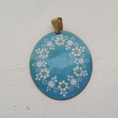 SOLD Vintage pendant enamel on copper oval white and gold flowers on blue azure signed Edda Schlager vorm eva Scherer made in Austria listed by trendybindi, $30.00 #jewelry #fashion #accessories