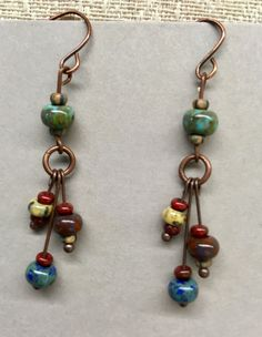 Copper dangle earrings made with Czech Picasso beads.