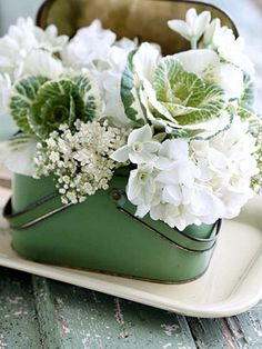 Vintage lunch box with hydrangeas, virurnum, paperwhites. and kale.