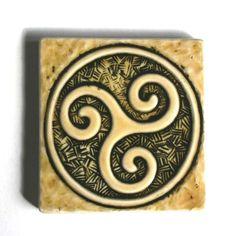 Spiral Triskele Celtic Symbol - Handmade Ceramic Tile - goldenrod/black. $20.00, via Etsy.