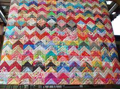 94″ square / Started with cutting 5″ charms / 484 Half-square triangles / Straight-line quilting / Quilter's Dream wool batting