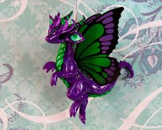 Purple Butterfly Dragon by DragonsAndBeasties.deviantart.com on @deviantART