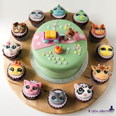 Littlest Pet Shop cake and cupcakes - Cake includes a toy as a gift fot the girl, but cupcakes are all in fondant.