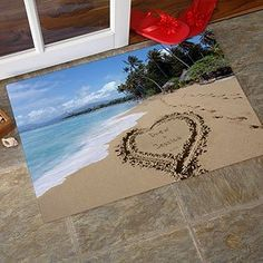 Personalized Door Mats - Sandy Beach Tropical Island Doormat . $22.95. What a creative way to welcome guests! Evoking the ambiance of a romantic and carefree beach stroll, a couple leaves behind their loving, and lasting imprint in the sand!Capture your own love through the sands of time beautifully depicted in our exclusive Our Paradise Island Welcome Mat. Our artist carves your first names within the sand heart creating a one-of-a-kind piece of art for you alone!
