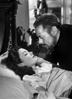 Gene Tierney  Rex Harrison in The Ghost and Mrs. Muir (1947).  One of my most favorite movies and love stories.