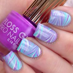 """3 #flossgloss shades from my loves at live.love.polish in a watermarble. Colors are flossgloss """"Wavepool"""" (teal), """"Glowstar"""" (green) and """"Lean"""" (purple"""" topped with chinaglazeofficial """"Fairy Dust"""""""