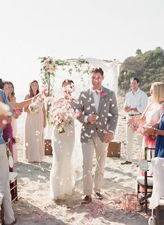 rose petal toss after beach wedding ceremony http://www.weddingchicks.com/2014/02/05/dos-pueblos-ranch-wedding-2/