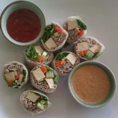 Buddha Rolls, lemongrass, ginger & chili infused tofu with buckwheat noodles, carrots, cucumber, spring onion & rocket, wrapped in a rice pancake with sweet chili and peanut dipping sauces
