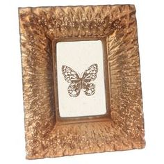 """Glass picture frame with harlequin motif.   Product: Picture frameConstruction Material: GlassColor: Amber Features: Holds one 4"""" x 6"""" photoDimensions: 10.5"""" H x 8.5"""" W"""