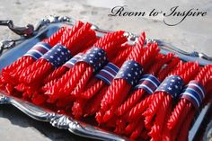 Add interest to your Fourth of July party by wrapping twizzlers or other stick candies with a strip of festive cardstock!  For sturdy cardstock to hold your candies together, check out www.cardstockshop.com.