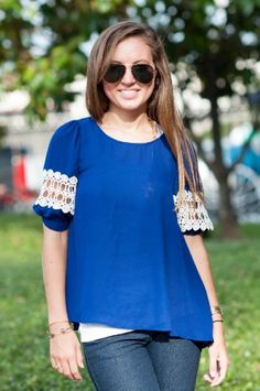 Royal blue top with crochet sleeve details - Studio 3:19