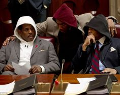 New York state senators Kevin Parker (left) Bill Perkins (center) and Eric Adams wear hooded sweatshirts during session in the Senate Chamber in Albany today to show their support for Florida teenager Trayvon Martin.