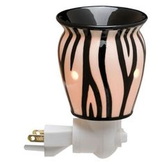 Wickless candles and scented fragrance wax for electric candle warmers and scented natural oils and diffusers. Shop for Scentsy Products Now! Scentsy Plug In Warmers, Wax Warmers, Candle Wax Warmer, Global Decor, Smell Good, Zebra Print, Jessie, Plugs, Fragrance