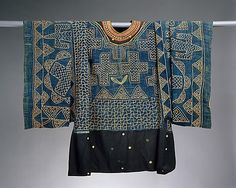 The Metropolitan Museum of Art | Prestige Gown Date: 19th–20th century Geography: Cameroon, Western Grassfields region Culture: Grassfields region Medium: Cotton, wool Dimensions: H x W: 86 1/4 x 45in. (219.1 x 114.3cm) Classification: Textiles-Woven Credit Line: Purchase, Dr. and Mrs. Sidney Clyman Gift and Rogers Fund, 1987 Accession Number: 1987.163