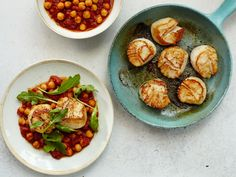 Tender, sweet scallops are paired with a tomato-rich garbanzo stew, here spiced with merkén, a traditional Chilean red chile spice mix.
