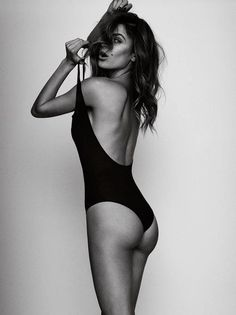 Black and white, bathing suit, fashion photography. Love the hair covering half the model's face (Cindy Crawford) and her expression. Use of bathing suit strap is great.