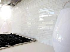 white glass tile backsplash Kitchen Midcentury with backsplash glass backsplash Glass Beige Cabinets, Backsplash For White Cabinets, Grey Backsplash, Glass Tile Backsplash, Backsplash Ideas, Tile Ideas, Tile Grout, Vanity Backsplash, Glass Tiles