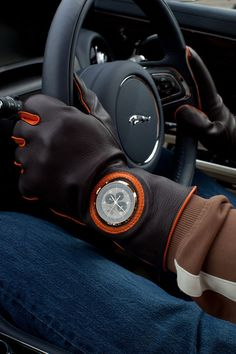 Time for a drive. What's not to love about this photo? From the Jaguar to the driving gloves, complete with a hole for your watch to peek through, we say nothing!