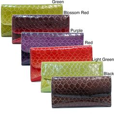 Embossed with the vivacious print and the texture of snakeskin, this faux-leather checkbook wallet has easy-access, top-flap entry. Six separate internal pockets keep items organized, and additional slots make it easier to find credit cards and IDs.