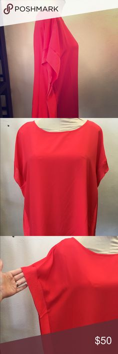 Michael Kors Coral Blouse Size L NWT Michael Kors Coral Blouse NWT SIZE L. Looks great with statement necklaces and belted. Lightweight and comfy! KORS Michael Kors Tops Blouses