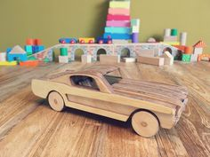 Wooden Toy Car Ford Mustang: 8 Steps (with Pictures) Holzspielzeugauto Ford Mustang – Gunook Diy Toys Car, Wooden Toy Cars, Wood Toys Plans, Bois Diy, Do It Yourself Crafts, Kids Wood, Car Ford, Auto Ford, Ford Mustang Gt