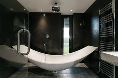 Patrick's bath. See more images here http://selfbuild.ie/featured/grillagh-water-house-patrick-bradley/