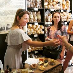 Our food specialist guide, Dorina, offering Greek goodies to her guests! 💗 #Athens #foodtour #greekfood | Greece
