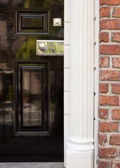 S.R. Gambrel Portfolio Image, gloss black front door, white trim, red brick