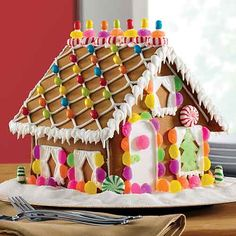 With the holidays right around the corner, nothing quite says Christmas like a h… - killtoe. Gingerbread House Candy, Homemade Gingerbread House, Graham Cracker Gingerbread House, Gingerbread House Patterns, Gingerbread House Template, Gingerbread Decorations, Gingerbread House Decorating Ideas, Gingerbread Cookies, Christmas Decorations