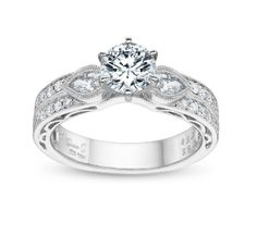 Simon G. with pear and round diamonds. Robbins Brothers