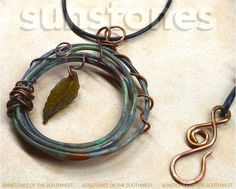 Originally $38 I began this necklace by annealing a length of 12 gauge copper wire. After forming it into the desired shape of a twig wreath, I added a beautiful patina. Using 16 and 18 gauge annealed wire, I created vine type adornments. Suspended from the center is a lucite leaf, in deep green. The cord is black rolled leather, 2mm thick, and the clasp is hand forged from copper. Very organic! Length of the necklace is 19 1/4, with the pendant adding an additional 3. ITEM PN2377…