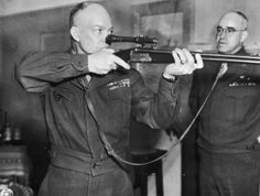 Commanding General of U.S. Army Europe, Dwight D. Eisenhower (1890 - 1969) firing a German-made combination rifle-shotgun with telescopic sight, during a tour of the third Army in Europe shortly before the German capitulation, 1945. Looking on is Omar Bradley (1893 - 1981) Commanding General of the 1st and 12th U.S. Army Groups. (Photo by US Army Signal Corps/FPG/Archive Photos/Getty Images)