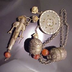 Antique Chinese necklace with rattles, needlecase, carved jade pendant and carnelian beads.