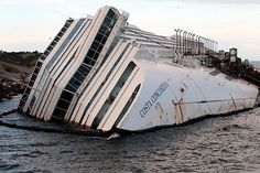 This Italian cruise ship ran aground on a reef off the coast of Tuscany, Italy…