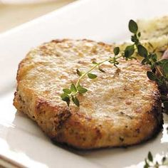 Busy-Day Baked Pork Chops Recipe -•1/4 cup fat-free milk  •1/4 cup grated Parmesan cheese  •1/4 cup seasoned bread crumbs  •1/4 teaspoon salt  •1/4 teaspoon garlic powder  •1/8 teaspoon pepper  •4 boneless pork loin chops (4 ounces each)  •Cooking spray