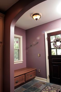 A small mud entry alcove at the back door has hooks for coats and a storage bench perfect for pulling off wet shoes.