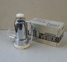 Vintage electric espresso maker (2-3 cup), by Velox ,Ferrara Italy 1960s -70s. Chrome stainless steel body , ivory plastic stand/closing screw . Marked ING P Malago Velox Patent , Ferrara ( Italia ). Bottom stamped made in Italy , 200/220 V ,2-3 tazze. Near mint condition in original box with papers , in working condition ,with no damage . Photos are of original item ,Electric, uses 200 /220 V . Approximate measurements Height - 8.4 inches (21 cm ). Diameter at base - 4 inches ...