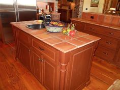 8-inch Saltillo Terracotta Mexican tile on the kitchen counters.