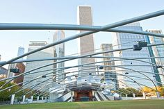 The Jay Pritzker Pavilion was a centerpiece in the transformation of downtown Chicago rail yards into Millennium Park public square. Gehry framed the performance venue in brushed stainless-steel ribbons, which reach out toward the Great Lawn in the form of steel piping that also encloses sound distribution. The audio system has been treating audiences to concert-hall acoustics for more than a decade.