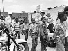 Police send a group of African American school children to jail, following their arrest for protesting against racial discrimination near the city hall of Birmingham, Ala., on May 4, 1963. (Bill Hudson/AP)