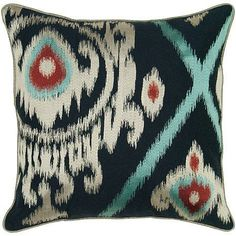 This decorative pillow from India Hicks adds just enough unique detail to play up a theme or create a focal point in a room.