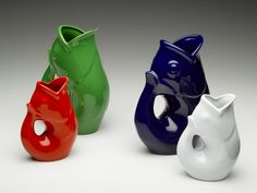 Large and small gurgle pots, available in a variety of colors.  They gurgle when you pour out of them!