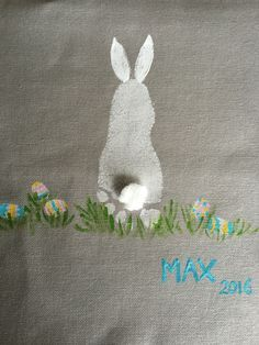 Easter bunny using footprint and fingerprints for eggs