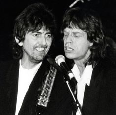 "George Harrison and Mick Jagger on stage at the Rock and Hall of Fame Awards, 20 January 1988. Photo by Ron Galella.  """"As a guitar player, [George] certainly had some nice and memorable licks on those Beatles tunes. Without being a virtuoso, he came..."