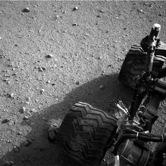 Soil clinging to the right middle and rear wheels of NASA's Mars rover Curiosity can be seen in this image taken by the Curiosity's Navigation Camera after the rover's third drive on Mars.