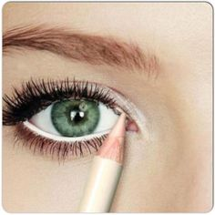 One neat trick to create the illusion of a larger eye is to use a white eyeliner pencil to white-out your waterline. This immediately makes the white of your eye look noticeably bigger and thus more youthful.: