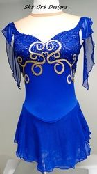 Sapphire blue with gold metallic scrolls, wispy sleeves and side wrap skirt, Sk8 Gr8 Designs. www.sk8gr8designs.com
