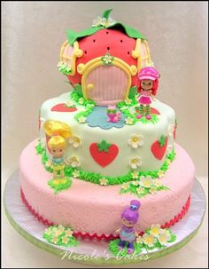 Best Strawberry Shortcake I have seen by far! It has her house, flowers, strawberries and a couple of her friends! I NEED THIS CAKE! Lol