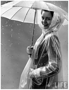 Mimi Berry modeling new synthetic rainwear, 1941 by photographer, Gion Mili. S)